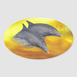 Dolphins surfing the waves oval sticker