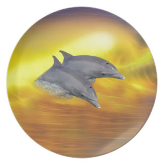 Dolphins surfing the waves plate