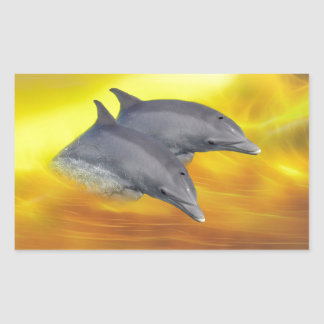 Dolphins surfing the waves rectangular sticker