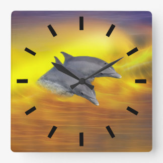 Dolphins surfing the waves square wall clock