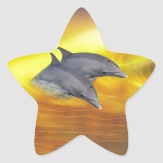 Dolphins surfing the waves star sticker