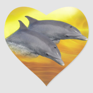 Dolphins surfing the waves sticker