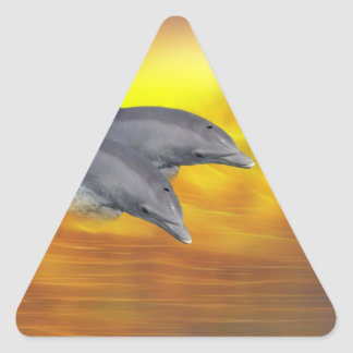 Dolphins surfing the waves triangle sticker