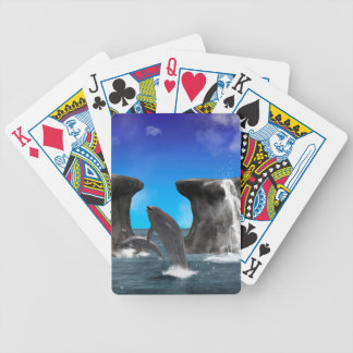 Dolphins swim and jumping in the sea card deck