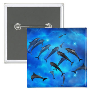 Dolphins swimming in the ocean pinback button