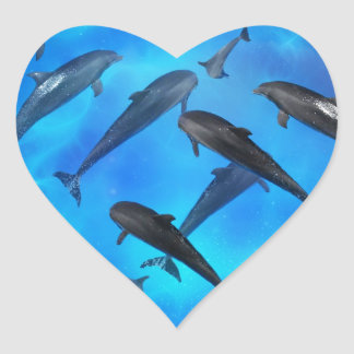Dolphins swimming in the ocean heart sticker