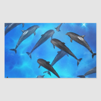 Dolphins swimming in the ocean rectangular sticker