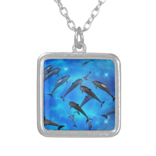 Dolphins swimming in the ocean silver plated necklace