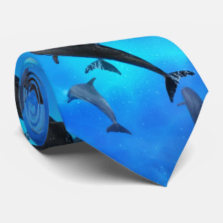 Dolphins swimming in the ocean tie