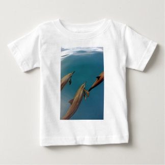Dolphins swimming in tropical lagoon Tahiti Baby T-Shirt