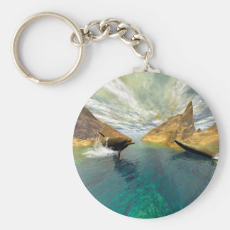 Dolphins swimming keychain