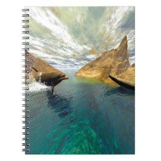 Dolphins swimming notebook