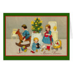 Domestic Christmas Scene with Kids and Toys Greeting Cards