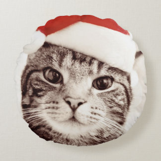 Domestic tabby cat wearing red Christmas hat Round Pillow