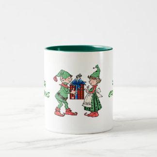 Donante del regalo de los duendes del navidad del taza dos tonos