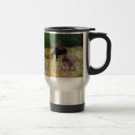 Donkey and horse in a Fall Field. Coffee Mug