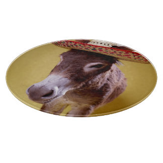 Donkey (Equus hemonius) wearing straw hat Cutting Board