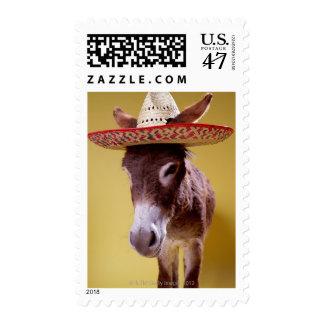 Donkey (Equus hemonius) wearing straw hat Postage Stamp