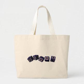 Donna toy blocks in blue bag