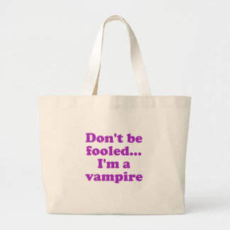 Dont be fooled... im a vampire. tote bag