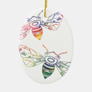 Doodles multicolores de la abeja adorno navideño ovalado de cerámica
