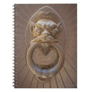 Door knocker in Siena, Italy. Spiral Notebooks