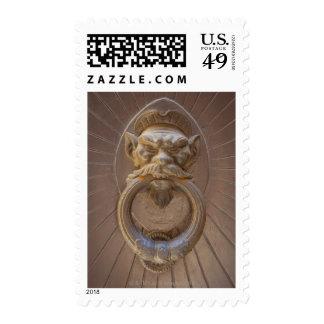 Door knocker in Siena, Italy. Postage Stamp