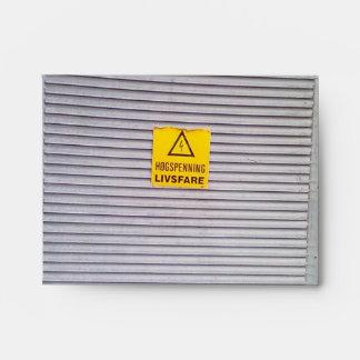 Door with danger warning on envelope