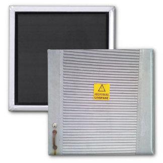 Door with danger warning on magnet