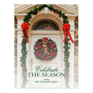 Door with wreath and Christmas decorations. Postcard