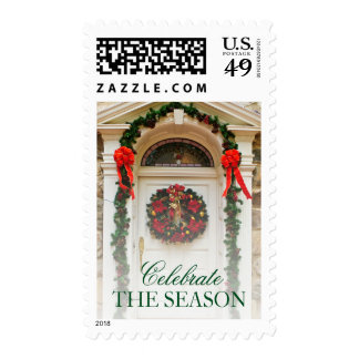 Door with wreath and Christmas decorations. Stamps