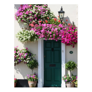 Doorway surrounded by flowers post card