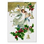 Dos ángeles del navidad con la tarjeta de Belces