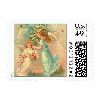 Dos ángeles del navidad del amor y de la paz sello postal