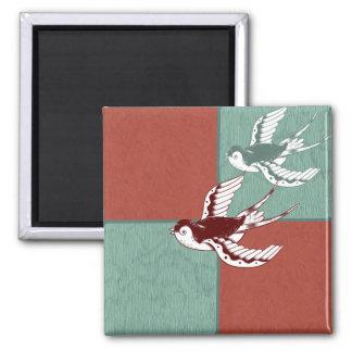 Dos bloques del color de azul rojo de los pájaros  imán de frigorífico