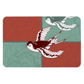 Dos bloques del color de azul rojo de los pájaros  iman