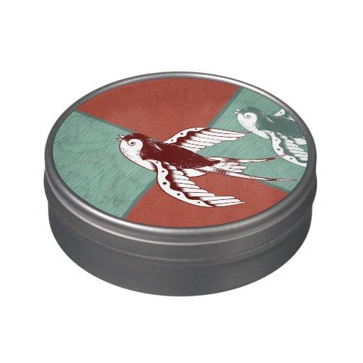 Dos bloques del color de azul rojo de los pájaros  jarrones de dulces