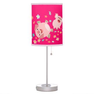 Dos cerdos lindos del dibujo animado en lámpara de