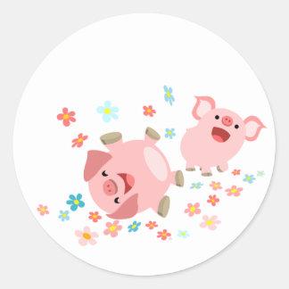 Dos cerdos lindos del dibujo animado en pegatina d