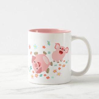 Dos cerdos lindos del dibujo animado en taza de la