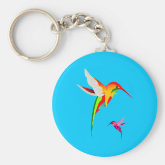Dos colibríes coloridos del vuelo llavero redondo tipo pin