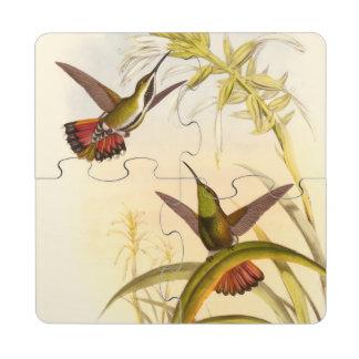 Dos colibríes coloridos que apuntan para la misma posavasos de puzzle