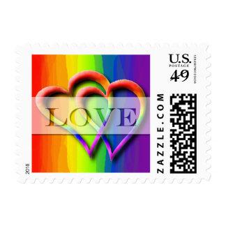 Dos colores gay unidos corazones del arco iris del timbre postal