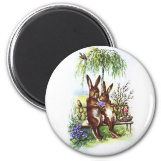 Dos conejos en un banco imán redondo 5 cm