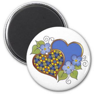 Dos corazones con colores primarios de los flores imán redondo 5 cm