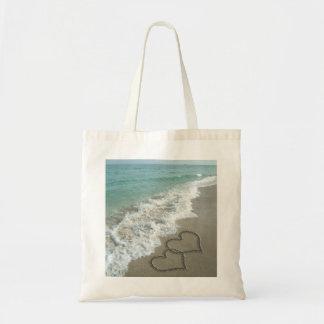 Dos corazones de la arena en la playa, océano romá bolsa tela barata