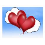 Dos corazones del globo con la nube postal