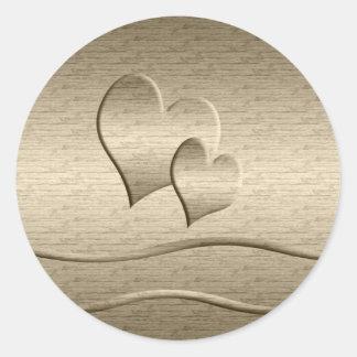 Dos corazones del oro etiqueta redonda