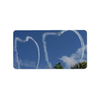 dos corazones dibujados por los aeroplanos sobre l etiqueta de dirección
