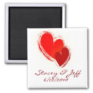 Dos corazones en amor imán de frigorífico
